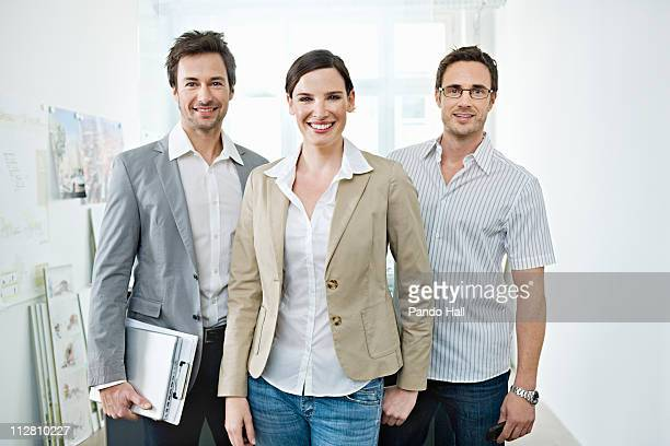 Group of business people in office, smiling