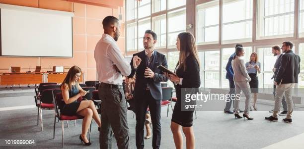 group of business people in the conference room - conference stock pictures, royalty-free photos & images