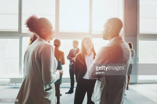 group of business people in the convention center - convention center stock pictures, royalty-free photos & images
