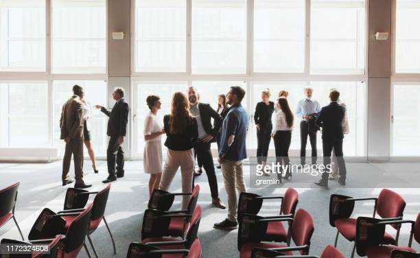group of business people in the convention center - conference stock pictures, royalty-free photos & images