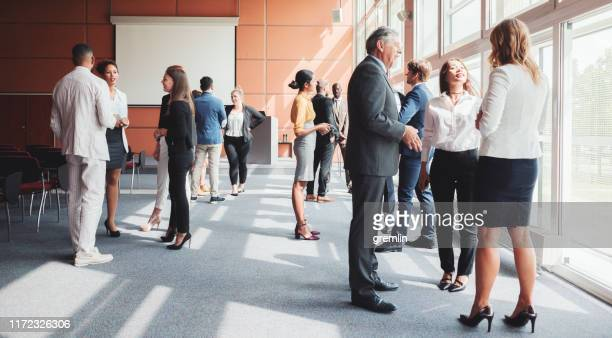 group of business people in the convention center - conference centre stock pictures, royalty-free photos & images