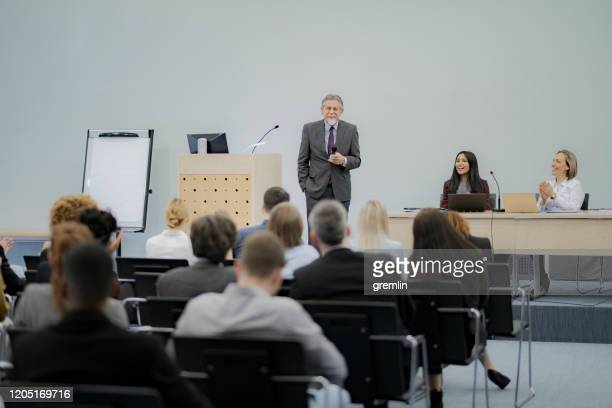 group of business people in the convention center - panel discussion stock pictures, royalty-free photos & images