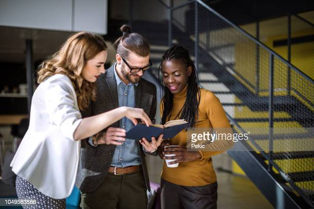 group of business people in the office building lobby - generation z stock pictures, royalty-free photos & images