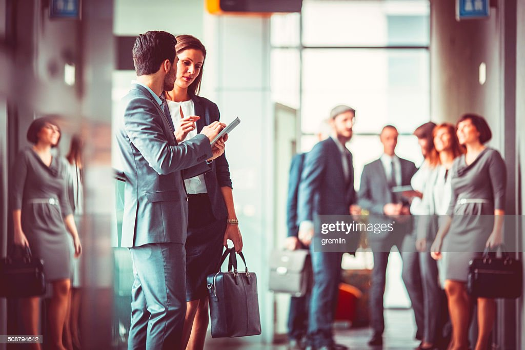 Group of business people in the office building lobby : Stock Photo