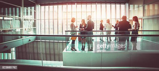 group of business people in the office building lobby - event stock pictures, royalty-free photos & images