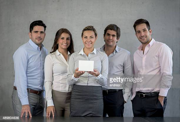 Group of business people introducing a new product