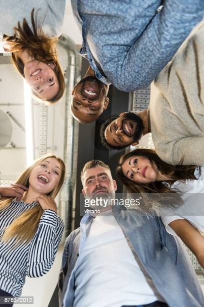 Group of business people looking down