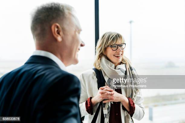 group of business people meeting at the airport and talking - business relationship stock pictures, royalty-free photos & images