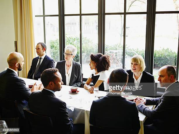 Group of business people meeting in restaurant