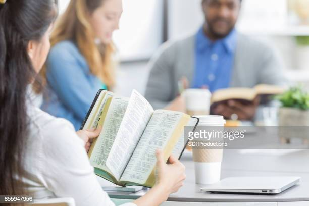 Group of business people participate in Bible study
