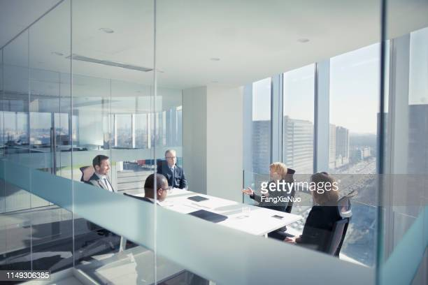 group of business people sitting in meeting - small group of people stock pictures, royalty-free photos & images