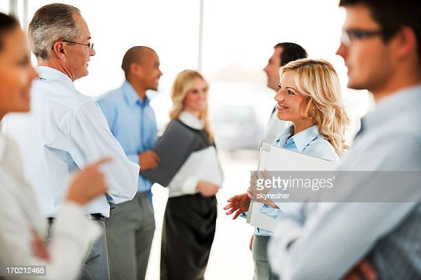 Group of business people standing and talking
