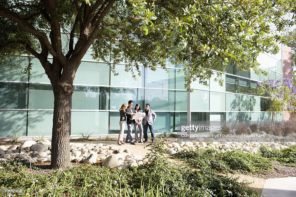 Group of business people standing outside : Stock Photo