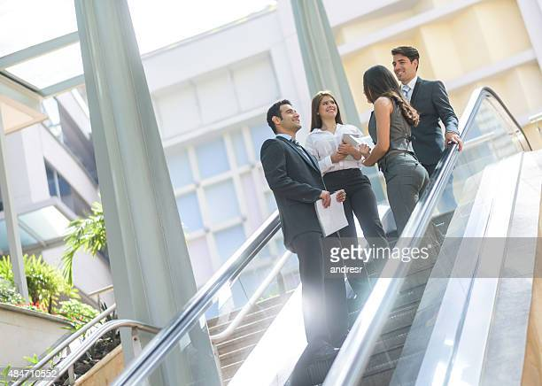 Group of business people talking at the office