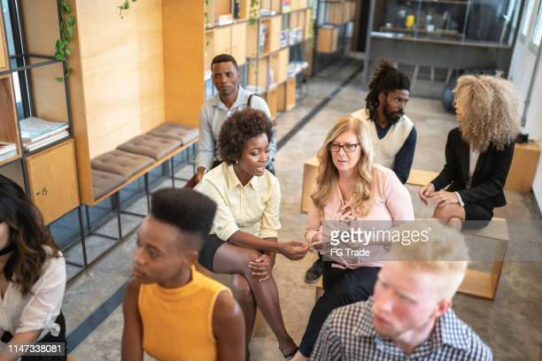 group of business people talking during seminar - participant stock pictures, royalty-free photos & images