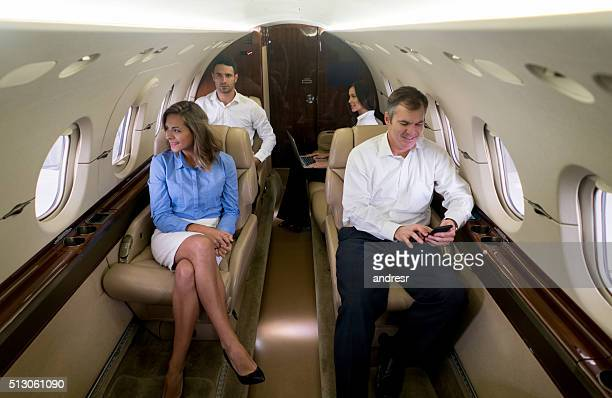 Group of business  people traveling by plane