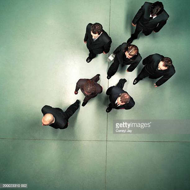 Group of business people walking, overhead view