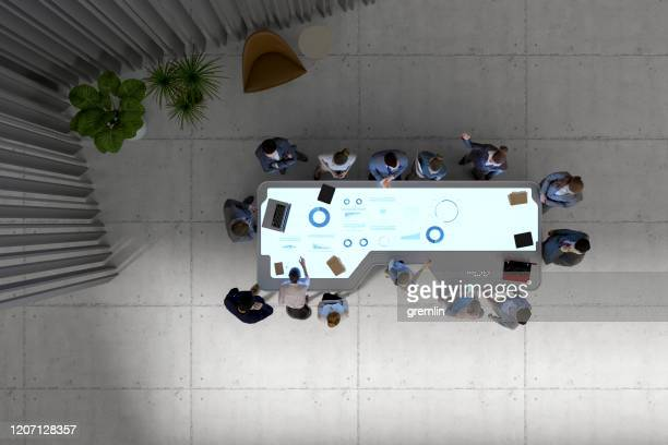 group of business people with futuristic working desk - interactivity stock pictures, royalty-free photos & images