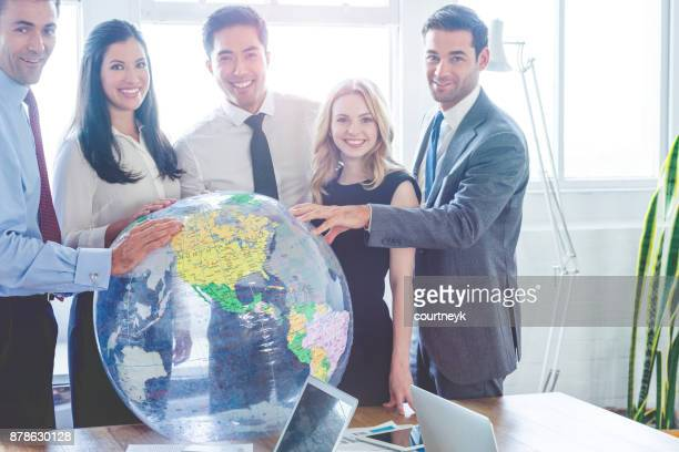 group of business people with globe. - responsible business stock photos and pictures