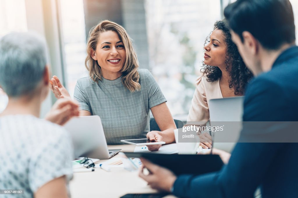 Group of business persons in discussion : Stock Photo