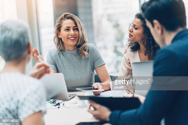 group of business persons in discussion - smiling stock pictures, royalty-free photos & images