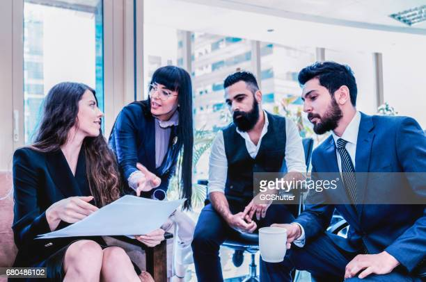 Group of business professionals brainstorming about their new startup