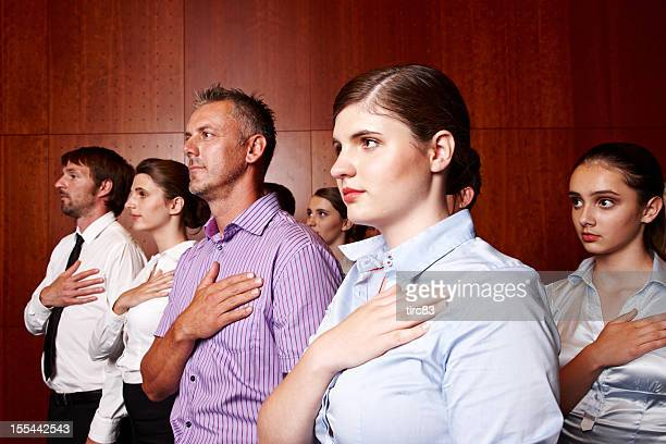group of businessman and businesswomen hands on hearts - oath stock pictures, royalty-free photos & images