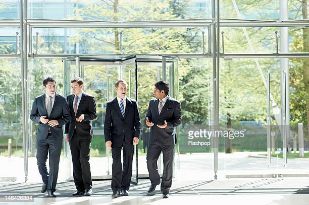 group of businessmen in discussion - 入る ストックフォトと画像