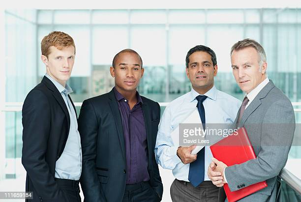 group of businessmen in office - vier personen stockfoto's en -beelden