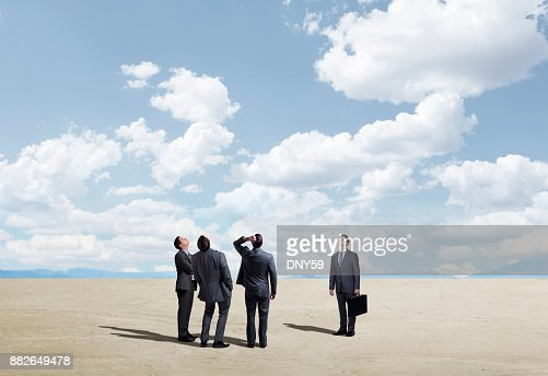 Group Of Businessmen inexplicably Looking Up To The Sky