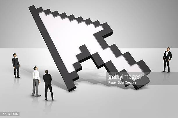 group of businessmen looking at a giant 3d cursor