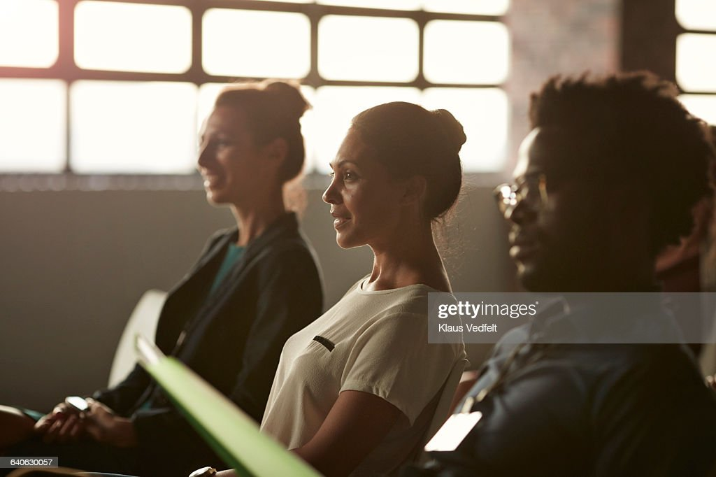 Group of businesspeople at lecture in auditorium : Stock Photo