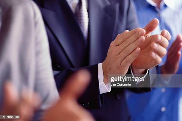 group of businesspeople clapping - jim craigmyle stock pictures, royalty-free photos & images