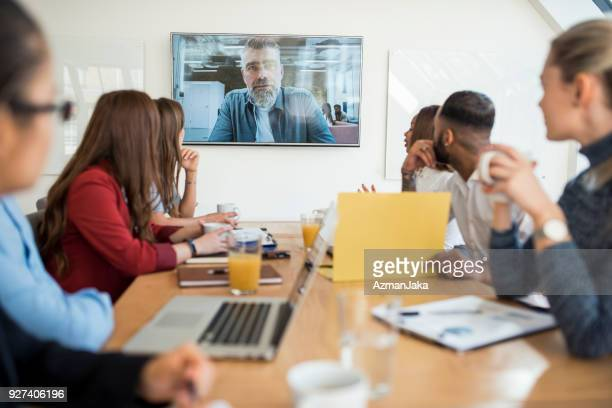 group of businesspeople having a video conference call with their superior - virtual meeting stock pictures, royalty-free photos & images