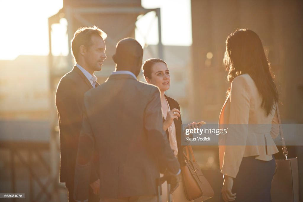Group of businesspeople having discussions outside : Stock Photo