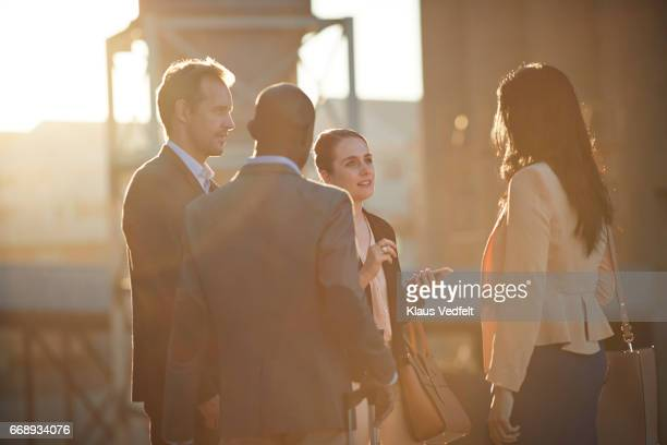 Group of businesspeople having discussions outside