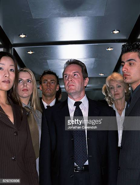 Group of Businesspeople in Elevator