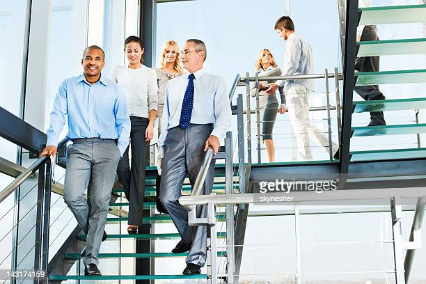 Group of businesspeople people on the staircase.