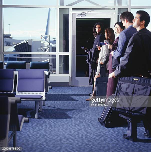 Group of businesspeople waiting to boarding airplane in airport