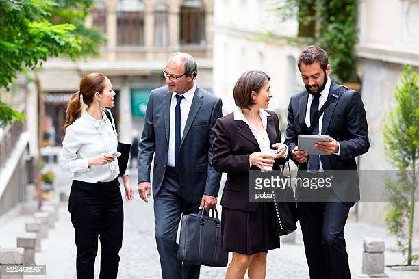Group Of Businesspeople walking down the street