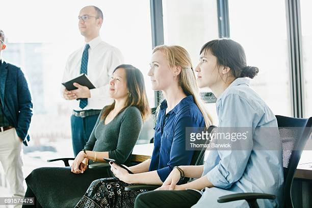 Group of businesswomen listening to presentation