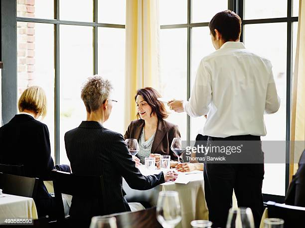 Group of businesswomen meeting in restaurant