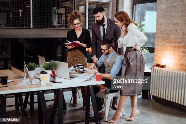Group of busy business people working in office