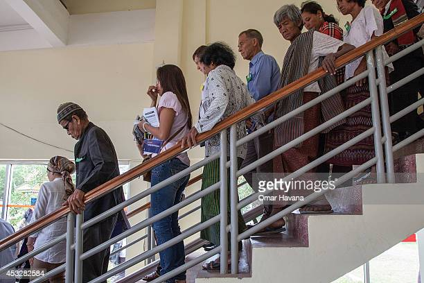 A group of Cambodians stand in line inside the Extraordinary Chambers in the Courts of Cambodian after the announcement of the verdict for former...