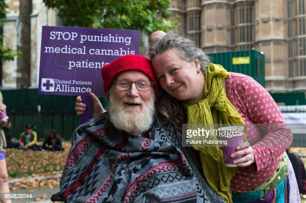 A group of campaigners and patients take part in a protest organised by the United Patients Alliance outside Houses of Parliament in central London...