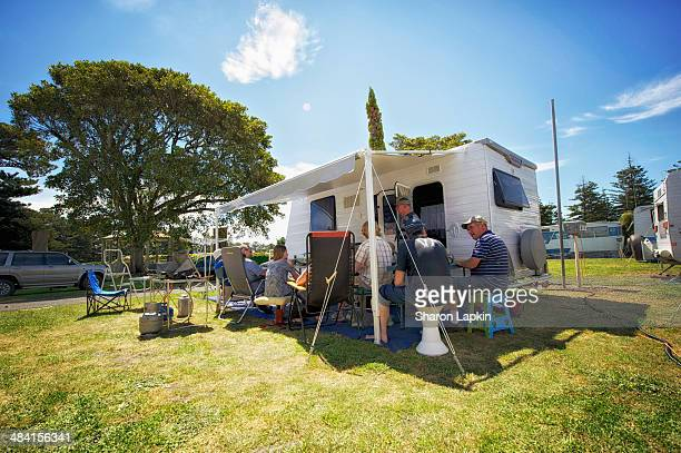 Group of campers and extended family sharing a barbecue in a camping ground on Australian coast