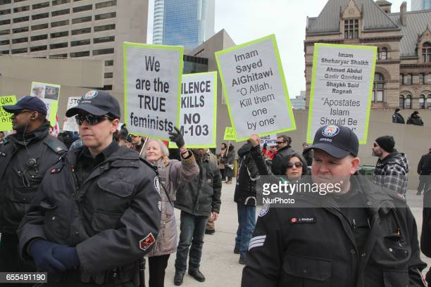 A group of Canadians gathered to protest against Islam Muslims Sharia Law and M103 in downtown Toronto Ontario Canada on March 19 2017 Canadians...