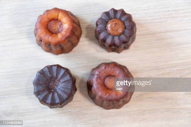 Group of caneles with various flavor, chocolate, and caramel. high angle shot, aerial view