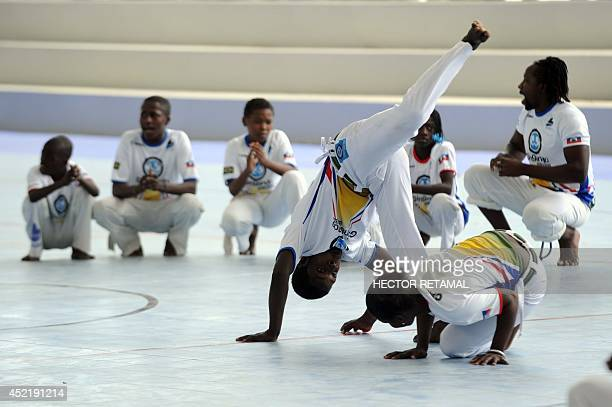 A group of Capoeira participate during the inauguration of the new facilities on July 15 2014 of the Sports for Hope Centre in Port au Prince Haiti...