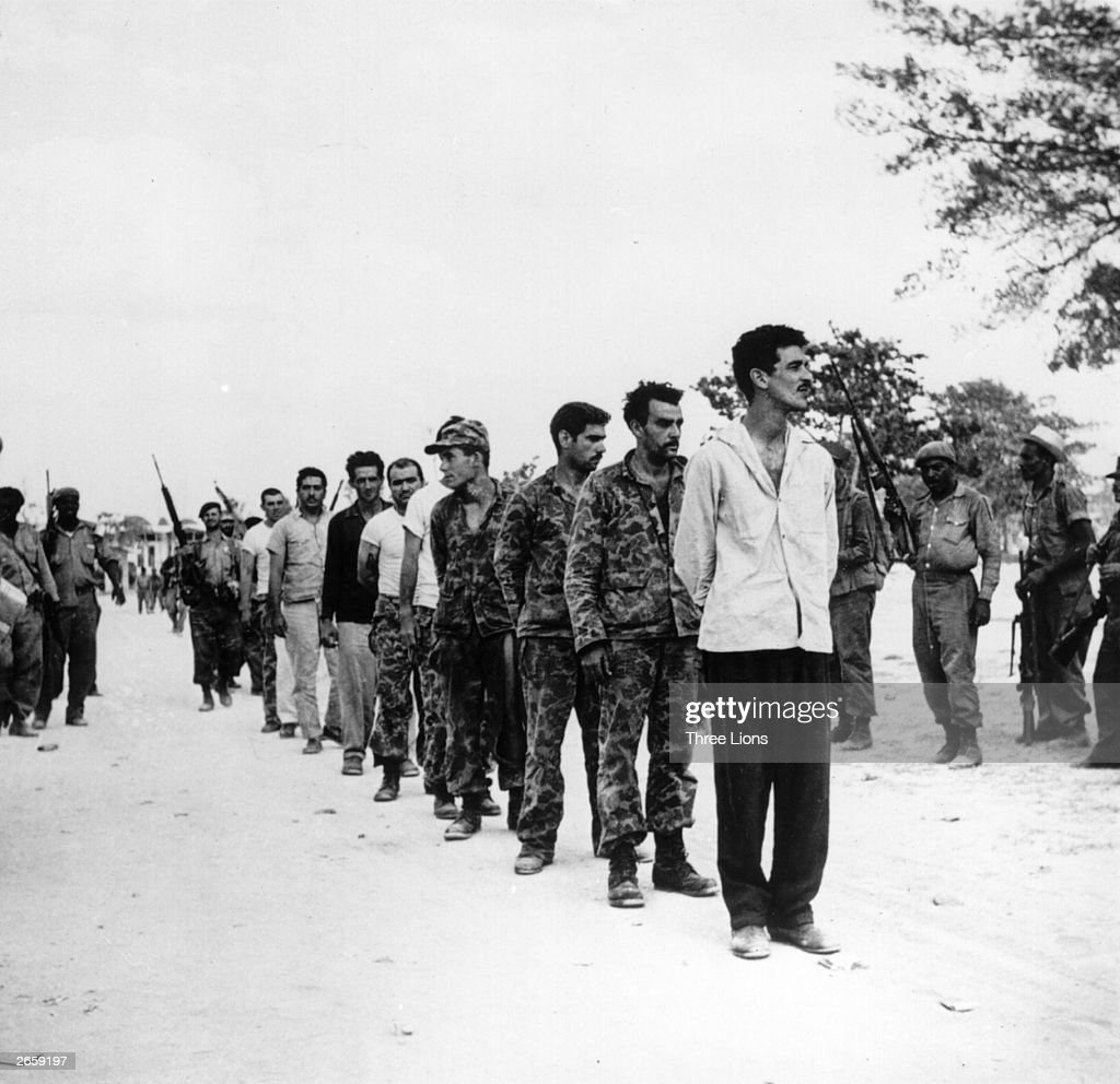 A group of captured Cubans are lined up by Castro's soldiers on the Playa de Giron, Cuba, mid-late April, 1961. They are of the US-backed force of Cuban exiles (known as Brigade 2506) who attempted invasion at the Bay of Pigs.
